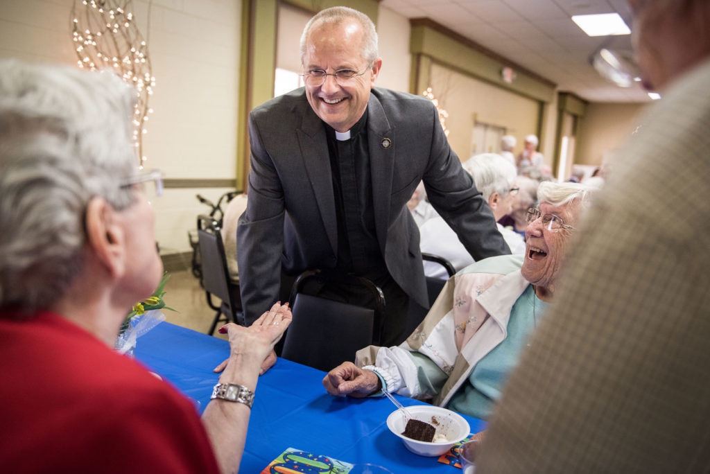The Rev. Wally Arp, senior pastor of St. Luke's Lutheran Church, talks with (L-R) Carolyn Merrick, John Bowen, and Betsy Hemphill, during a birthday party for a 100 year-old parishioner at Lutheran Haven on Saturday, March 5, 2016, in Oviedo, Fla. LCMS Communications/Erik M. Lunsford